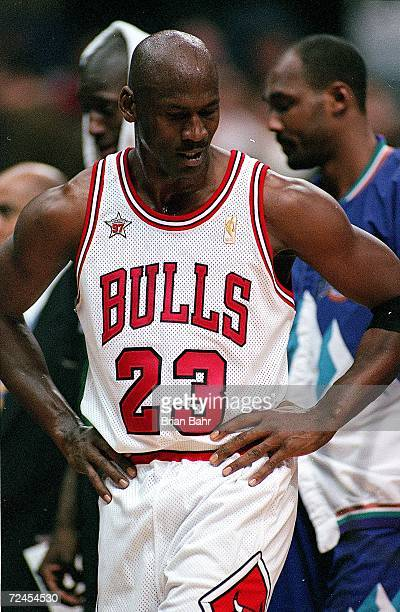 Michael Jordan of the Chicago Bulls walks on the court during the NBA AllStar Game at the Gund Arena in Cleveland OhioThe East defeated the West...