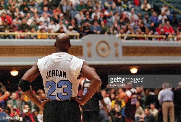 Michael Jordan of the Chicago Bulls watches the fans during the NBA AllStar Practice at the Gund Arena in Cleveland OhioThe East defeated the West...