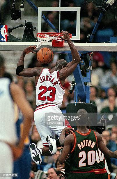 Michael Jordan of the East dunks the ball during the NBA AllStars Game against the West at the Gund Arena in Cleveland Ohio The East defeated the...