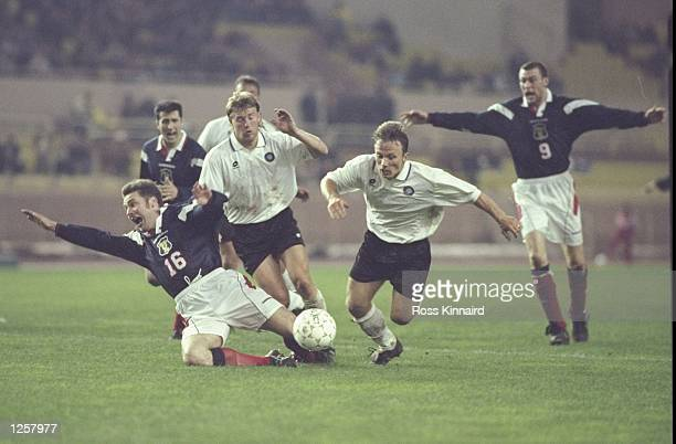Scotland appeal as Ally McCoist is fouled during the World Cup qualifier between Estonia and Scotland at the Stadium St Louis the II in Monaco The...