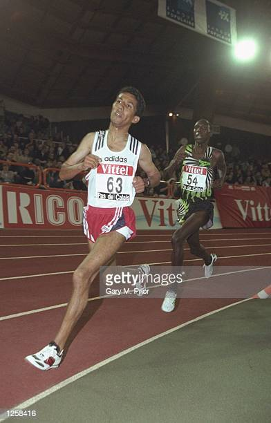 Smail Sghir of Morocco passes Moses Kiptanui of Kenya during the Ricoh Indoor Tour Vittel Pas Du Calais Meet in Lievin, France. \ Mandatory Credit:...