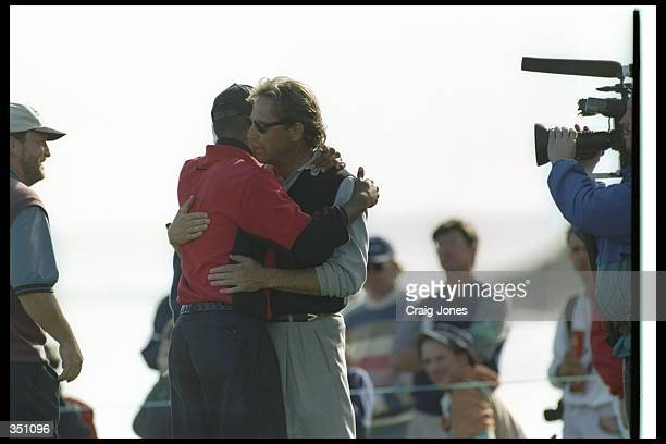 Tiger Woods and actor Kevin Costner celebrate during the ATT Pebble Beach Pro Am at the Pebble Beach Golf Course in Pebble Beach California Mandatory...