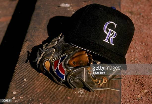 General view of a glove and a Colorado Rockies cap during a spring training game between the Colorado Rockies and the San Francisco Giants at the Hi...