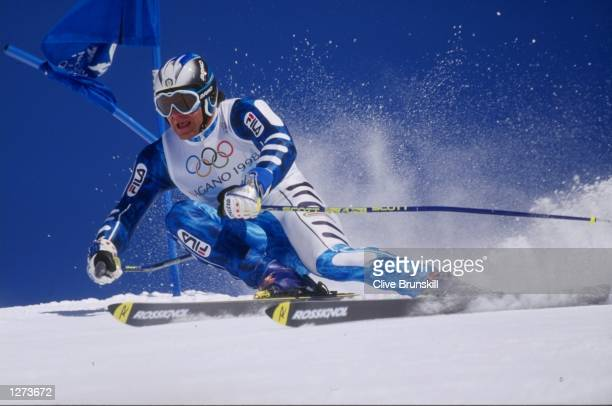 Alberto Tomba of Italy falls during the mens giant slalom at Shiga Kogen during the 1998 Olympic Winter Games in Nagano Japan Mandatory Credit Clive...