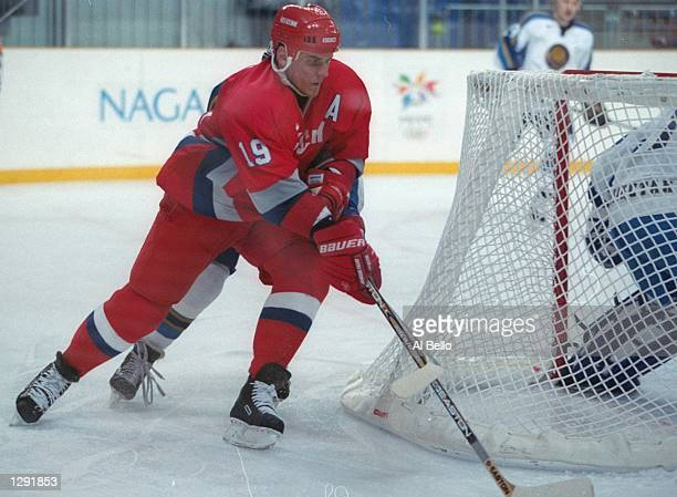 Alexei Yashin of Russia in action against Kazakstan at the Aqua Wing Arena during the 1998 Olympic Winter games in Nagano Japan Mandatory Credit Al...