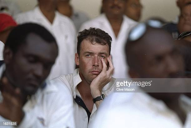 Angus Fraser of England looks dejected after defeat in the Second Test against the West Indies at the Queens Park Oval in Port of Spain, Trinidad....