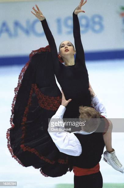 Anjelika Krylova and Oleg Ovsyannikov of Russia perform in the Skating Exhibition in the IceSkating championships during the 1998 Winter Olympics...