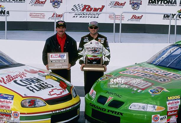 Brothers Terry and Bobby Labonte look on during practice for the Daytona 500 at Daytona International Speedway in Daytona Beach Florida