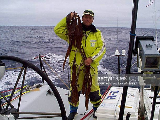 Christen Horn Johannessen of Norway displays strands of kelp which had become stuck around the keel and rudder of Innovation Kvaerner during the...