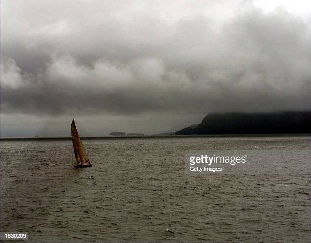 Fifth placed Merit Cup rounds Cape Horn under threatening skies during the fifth leg of the Whitbread Round the World Race for the Volvo Trophy...