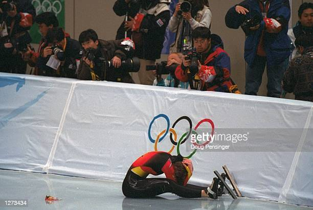 Franziska Schenk of Germany falls during her race of the 1000m speed skate at the MWave Arena during the 1998 Olympic Winter Games in Nagano Japan...