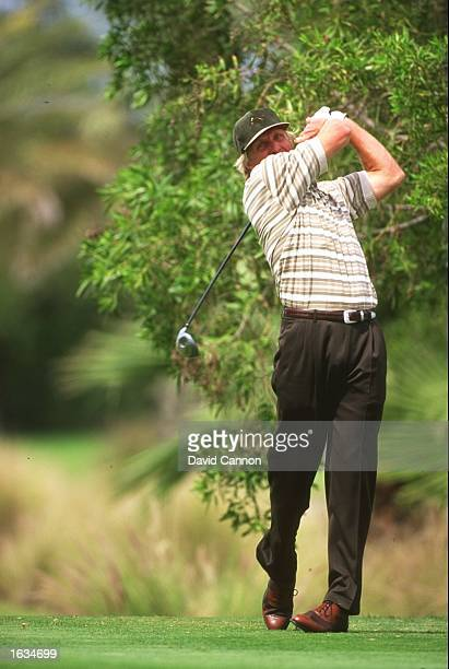 Greg Norman of Australia drives down the fairway during the Dubai Desert Classic at the Emirates Golf Club in Dubai United Arab Emirates Mandatory...