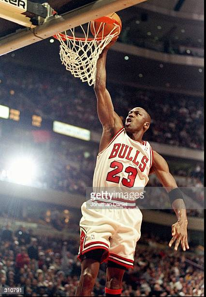 Guard Michael Jordan of the Chicago Bulls goes up for two during a game against the Atlanta Hawks at the United Center in Chicago Illinois The Bulls...