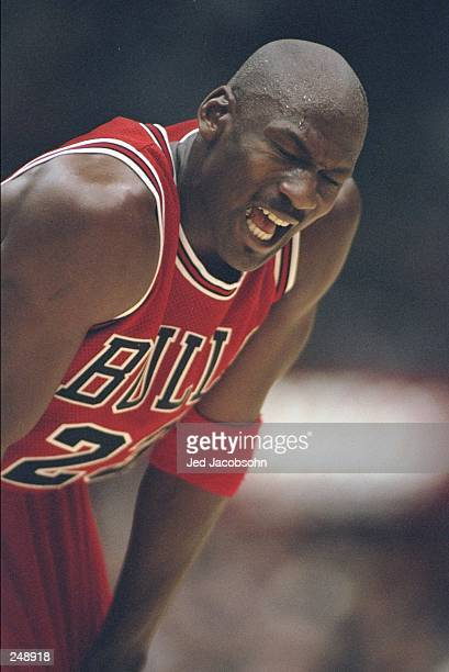 Guard Michael Jordan of the Chicago Bulls grimaces during a game against the Los Angeles Lakers at the Great Western Forum in Inglewood, California....
