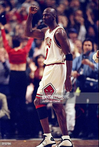 Guard Michael Jordan of the Chicago Bulls looks on during a game against the Atlanta Hawks at the United Center in Chicago, Illinois. The Bulls...