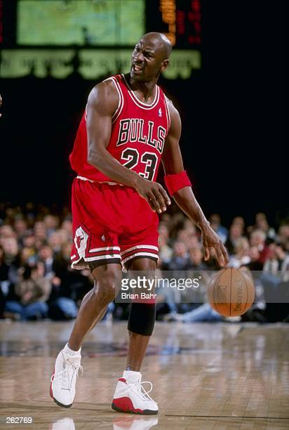 Guard Michael Jordan of the Chicago Bulls moves the ball during a game against the Denver Nuggets at McNichols Sports Arena in Denver Colorado The...