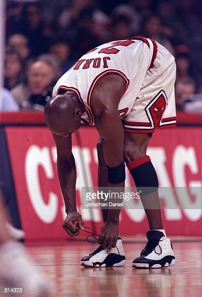 Guard Michael Jordan of the Chicago Bulls stretches during a game against the Detroit Pistons at the United Center in Chicago Illinois The Bulls won...