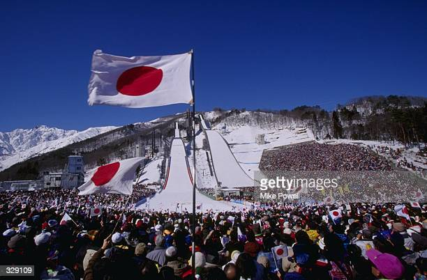 Japanese fans wave their flags at the ski jump venue of the nordic combined at Happo''One in Hakuba during the 1998 Winter Olympic Games in Nagano...