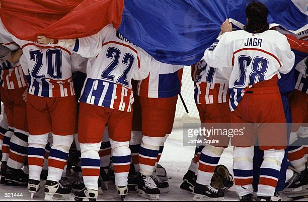 Jaromir Jagr of Czechoslovakia celebrates with his teammates in the final ice hockey match against Russia during the Winter Olympics in Nagano Japan...