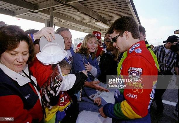 Jeff Gordon signs autographs for fans during the Nascar Daytona 500 at the Daytona International Speedway in Daytona Beach Florida Mandatory Credit...