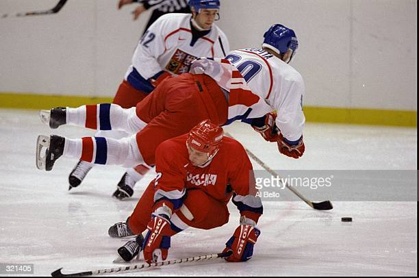Jiri Dopita of Czechoslovakia in action against Boris Mironov of Russia in the final hockey match during the Winter Olympics in Nagano Japan...