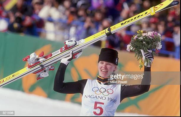 Katja Seizinger of Germany celebrates winning the women''s downhill event during the Winter Olympics in Nagano Japan Mandatory Credit Mike Powell...