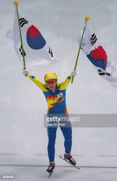 LeeKyung Chun of Korea wins the gold medal in womens 1000m short track speed skate at White Ring Arena during the 1998 Winter Olympic Games in Nagano...