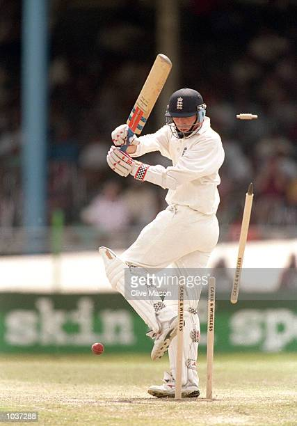 Mike Atherton of England is bowled during the Second Test against the West Indies at the Queen's Park Oval, Port of Spain, Trinidad. \ Mandatory...