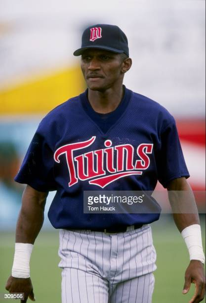 Otis Nixon of the Minnesota Twins looks on during a spring training game against the Texas Rangers at the Charlotte County Stadium in Port Charlotte,...