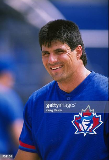 Outfielder Jose Canseco of the Toronto Blue Jays in action during a spring training game against the Philadelphia Phillies at the Grant Field in...