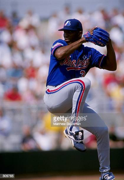 Pitcher Carlos Perez of the Montreal Expos in action during a spring training game against the St Louis Cardinals at the Roger Dean Stadium in...
