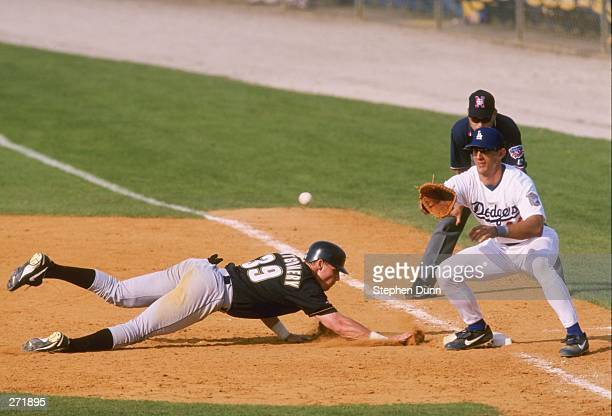 Ray Montgomery of the Houston Astros dives back to first base during a Spring Training game against the Los Angeles Dodgers at the Holman Stadium in...