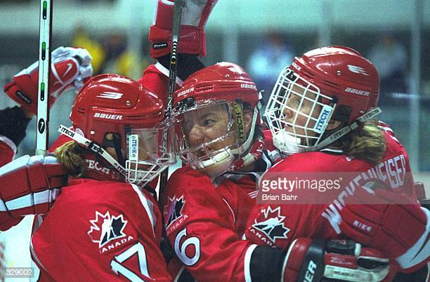 Stacy Wilson left Therese Brisson and Hayley Wickenheiser of Canada celebrate their 130 win over Japan at the Aqua Wing Arena during the 1998 Winter...
