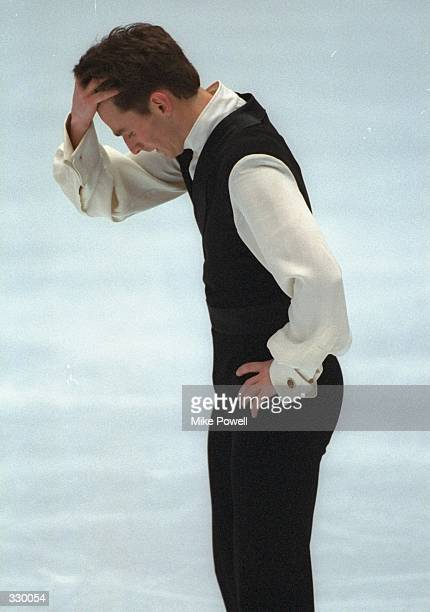 Todd Eldredge of the USA grabs his head after he finished a less than stellar performance in the mens free skate competition at White Ring Arena...
