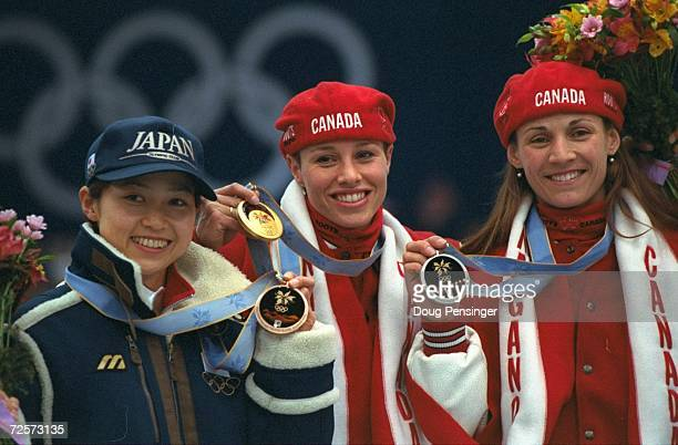 Tomomi Okazaki of Japan wins the bronze medal, Catriona Lemay-Doan of Canada wins the gold and Susan Auch of Canada wins the silver medal in the...