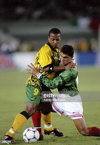 Two players fight for the ball during a CONCACAF Gold Cup game between Mexico and Jamaica at the Los Angeles Coliseum in Los Angeles California...
