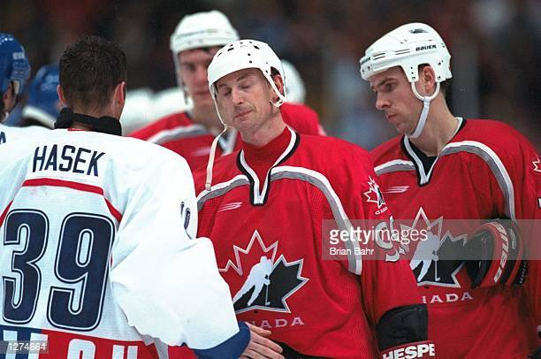 Wayne Gretzky of Canada is consoled by Dominik Hasek of the Czech Republic at Big Hat Arena during the 1998 Olympic Winter Games in Nagano Japan...