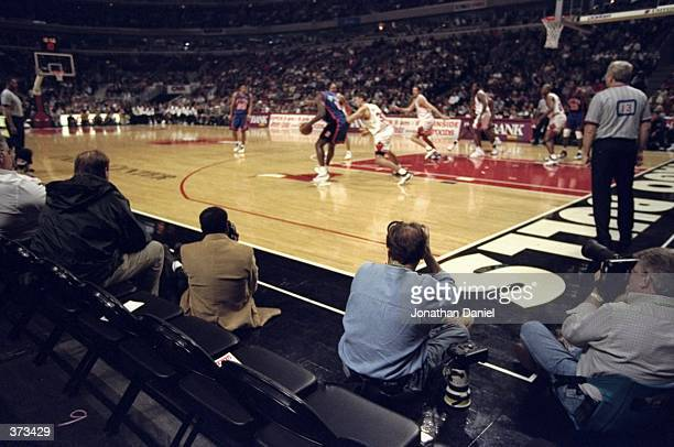 A general view of empty courtside seats during the game between the New York Knicks and the Chicago Bulls at the United Center in Chicago Illinois...