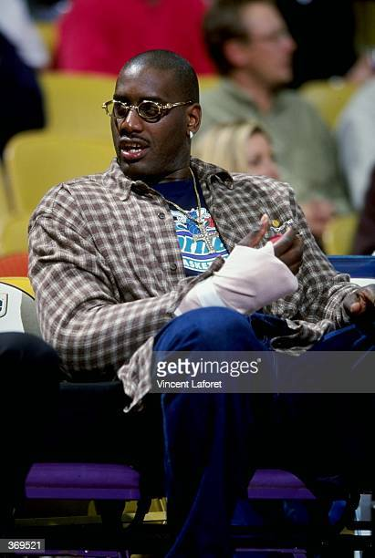 Anthony Mason of the Charlotte Hornets watches from the bench with a injured arm during the game against the Los Angeles Lakers at the Great Western...