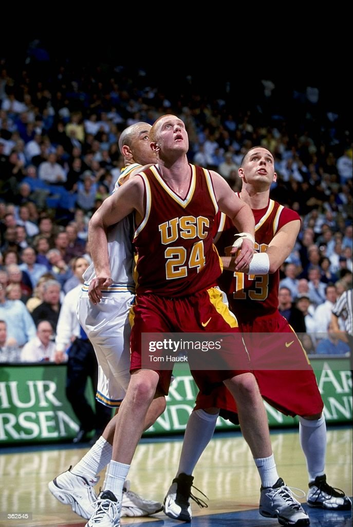 low priced 6e8e1 3977d Brian Scalabrine of the USC Trojans looks to recover the ...