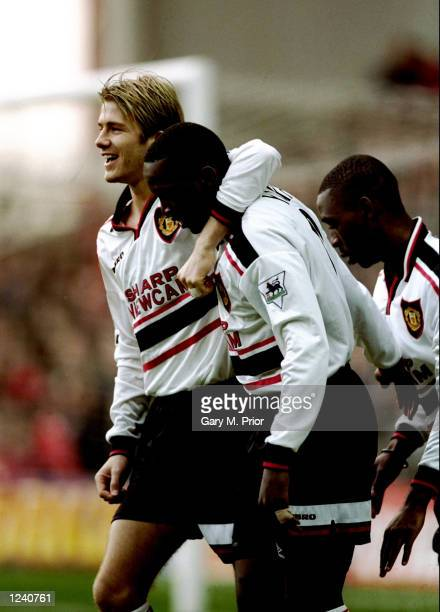 David Beckham and Dwight Yorke of Manchester United celebrate during the FA Carling Premiership match against Nottingham Forest played at the City...
