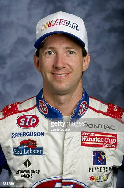 Driver John Andretti poses for a studio portrait during the NASCAR Daytona 500 Speedweek Winston Cup Series at the Daytona International Speedway in...