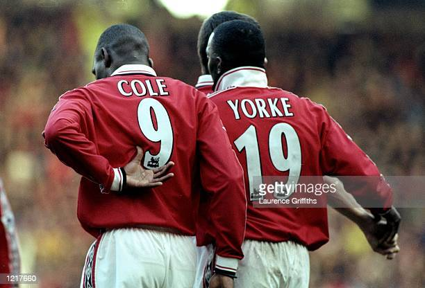 Dwight Yorke and Andy Cole of Manchester United celebrate a goal together during the FA Carling Premiership match against Southampton played at Old...