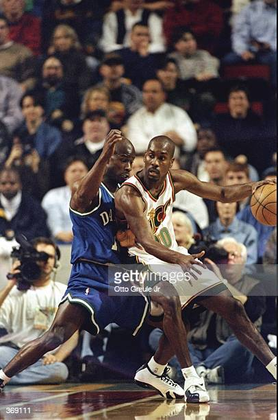 Gary Payton of the Seattle Supersonics dribbles during the game against the Dallas Mavericks at the Key Arena in Seattle Washington The Sonics...