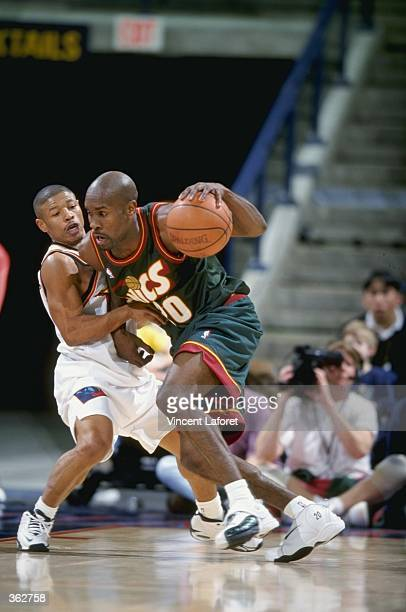Gary Payton of the Seattle Supersonics dribbles the ball during a game against the Golden State Warriors at the Oakland Coliseum in Oakland...