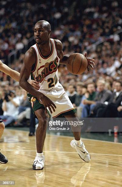 Gary Payton of the Seattle SuperSonics dribbles the ball during the game against the Sacramento Kings at the Key Arena in Seattle Washington The...
