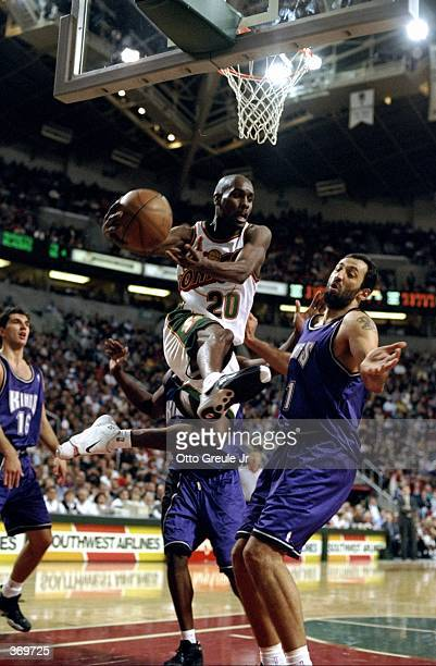 Gary Payton of the Seattle SuperSonics grabs the ball during the game against the Sacramento Kings at the Key Arena in Seattle Washington The Kings...