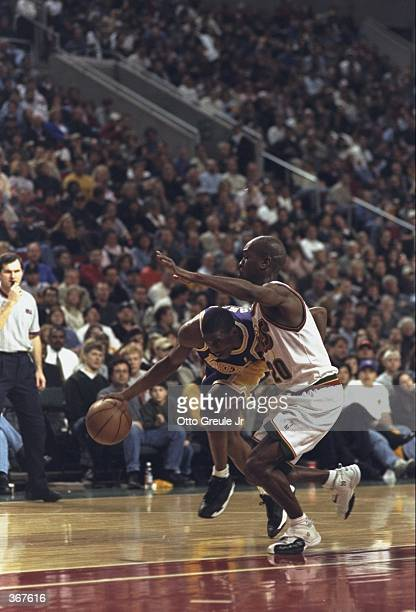 Gary Payton of the Seattle Supersonics guards during the game against the Los Angeles Lakers at the Key Arena in Seattle Washingon The Sonics...