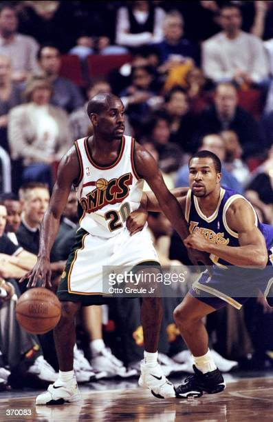 Gary Payton of the Seattle SuperSonics in action during the game against the Los Angeles Lakers at the Key Arena in Seattle Washington The Sonics...