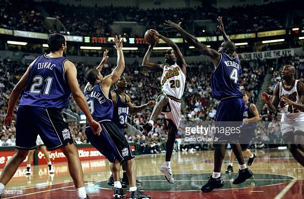 Gary Payton of the Seattle SuperSonics jumps to make a basket during the game against the Sacramento Kings at the Key Arena in Seattle Washington The...
